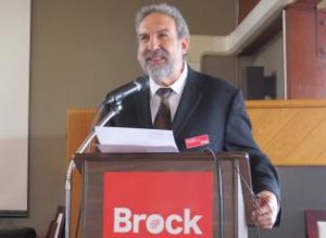 Photo of Dr. Libben giving a speech as Brock VPR.